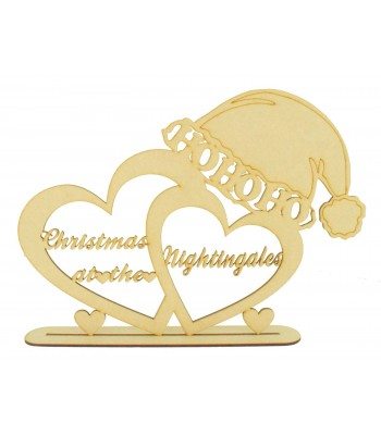 Laser Cut Personalised 'Christmas At The...' Double Hearts in a stand with Santa Hat on top