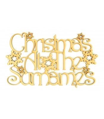 Laser Cut Personalised 'Christmas At The...' Sign with a Decorative Font and Snowflakes (Design 15)