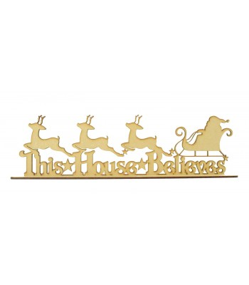 Laser cut 'This House Believes' with Santa and Reindeer Sign on a Stand