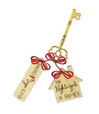 Laser Cut Oak Veneer Personalised 'Santa's Magic Key' with 'The...Family' House Shape Keyring Tag Set